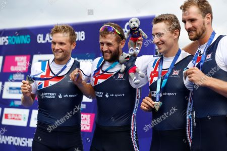 Thomas Ford, Jacob Dawson, Adam Neill and James Johnston, of Great Britain, pose with their silver medals on the podium of the Men's Four race final at the European Rowing Championships in Glasgow, Scotland