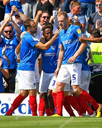 Goalscorer Jamal Lowe of Portsmouth middle is congratulated by Brett Pitman of Portsmouth left and Matthew Clarke of Portsmouth during Portsmouth vs Luton Town, Sky Bet EFL League 1 Football at Fratton Park on 4th August 2018