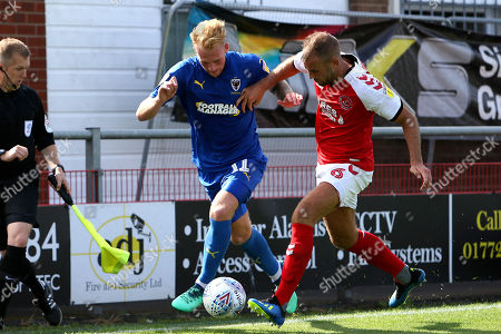 AFC Wimbledon midfielder Mitch Pinnock (11) takes on Fleetwood Town defender Tommy Spurr (6) during the EFL Sky Bet League 1 match between Fleetwood Town and AFC Wimbledon at the Highbury Stadium, Fleetwood. Picture by Craig Galloway