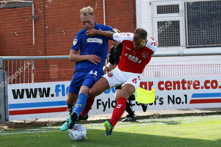 AFC Wimbledon midfielder Mitch Pinnock (11) and Fleetwood Town defender Tommy Spurr (6) during the EFL Sky Bet League 1 match between Fleetwood Town and AFC Wimbledon at the Highbury Stadium, Fleetwood. Picture by Craig Galloway