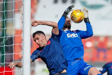 Aaron Hughes of Heart of Midlothian challenges goalkeeper Gary Woods of Hamilton Academical FC during the Ladbrokes Scottish Premiership League match between Hamilton Academical FC and Heart of Midlothian FC at New Douglas Park, Hamilton. Picture by Malcolm Mackenzie