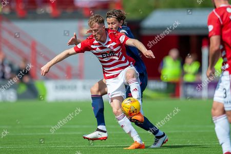 Sam Kelly of Hamilton Academical FC holds off Peter Haring of Heart of Midlothian during the Ladbrokes Scottish Premiership League match between Hamilton Academical FC and Heart of Midlothian FC at New Douglas Park, Hamilton. Picture by Malcolm Mackenzie