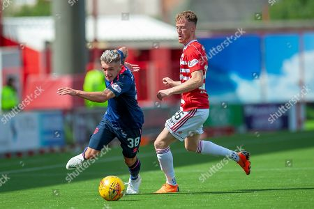 Stock Image of Callum Morrison of Heart of Midlothian breaks clear of Sam Kelly of Hamilton Academical FC during the Ladbrokes Scottish Premiership League match between Hamilton Academical FC and Heart of Midlothian FC at New Douglas Park, Hamilton. Picture by Malcolm Mackenzie