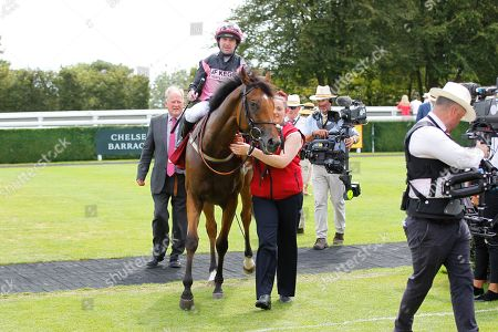 Stock Photo of Sir Chauvelin and Robert Winston win the Qatar Summer Handicap at Goodwood to complete a double for trainer Jim Goldie.