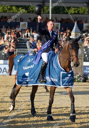 Scott Brash (GBR) riding Hello Mr President enter the arena after winning the Longines Champions Tour Grand Prix