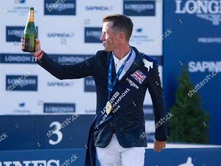 Scott Brash (GBR) celebrates with Champagne after winning the Longines Champions Tour Grand Prix