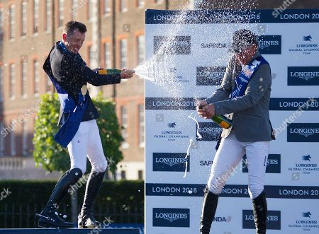 Scott Brash (GBR) and Ludger Bierbaum spray Champagne after the presentation for the Longines Champions Tour Grand Prix