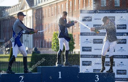 Peder Fredricson (SWE), Scott Brash (GBR) and Ludger Bierbaum (GER) spray Champagne after the presentation for the Longines Champions Tour Grand Prix