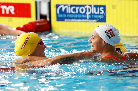 Winner Sarah Sjoestroem of Sweden, left, and second placed Pernille Blume of Denmark react at the end of the 50 meters freestyle women final at the European Swimming Championships in Glasgow, Scotland
