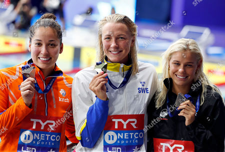 Bronze medalist Ranomi Kromowidjojo of the Netherlands, gold medalist Sarah Sjoestroem of Sweden and silver medalist Pernille Blume of Denmark, from left to right, pose with their medals on the podium of the 50 meters freestyle women final at the European Swimming Championships in Glasgow, Scotland