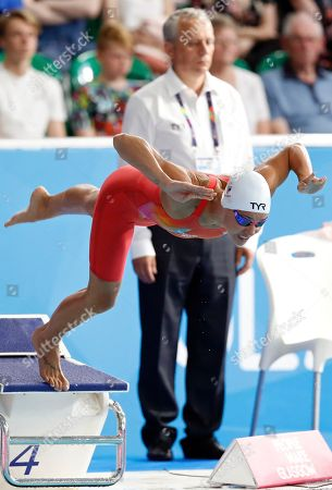 Pernille Blume of Denmark dives to win a silver medal in the 50 meters freestyle women final at the European Swimming Championships in Glasgow, Scotland