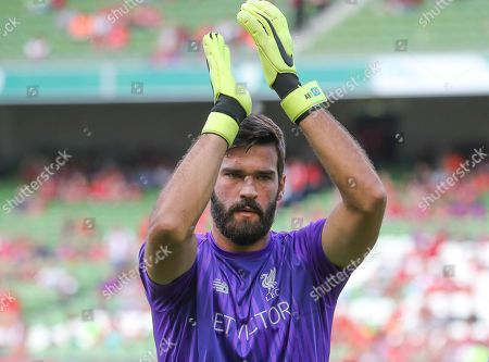 Liverpool Goalkeeper Alisson applauds the Fans as he comes out for warm up
