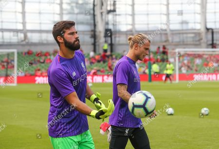 Liverpool Goalkeeper AlissonFans as he comes out for warm up with Loris Karius