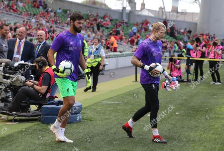 Liverpool Goalkeeper Alisson  as he comes out for warm up with Loris Karius