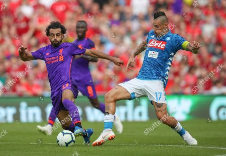 Mohamed Salah of Liverpool takes on Napoili Defence