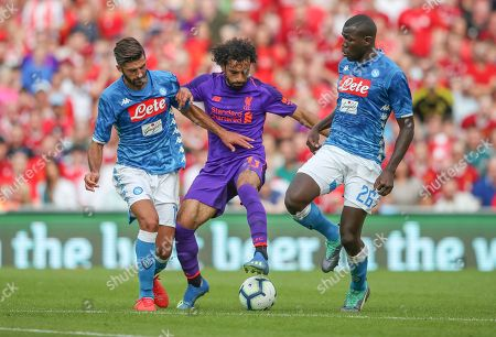 Stock Image of Mohamed Salah of Liverpool takes on Napoili Defence