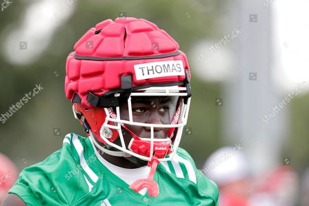Rutgers defensive lineman Matt Thomas works out during NCAA college football training camp, in Piscataway, N.J
