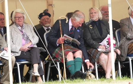 """Prince Charles enjoys a dram of """"Old Pultney"""" whisky that he got from local hotelier Murray Lamont whilst attending the Mey Highland games"""