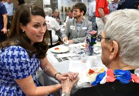 Kentucky Secretary of State Alison Lundergan Grimes, left, speaks with Calloway County Democratic Party leader Zee Enix at the Graves County Democratic Breakfast, in Mayfield, Ky