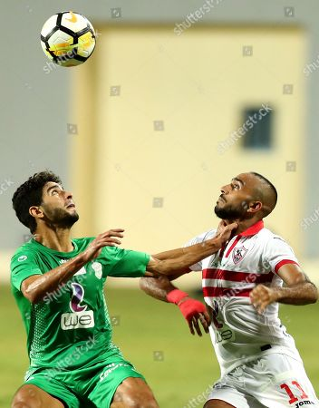 Zamalek player Kahraba (R)  in action against  Al-Ittihad player Ahmed Sherwada (L) during the Egyptian Premier League football match  between Zamalek and Al-Ittihad  in Cairo, Egypt, 04 August 2018.