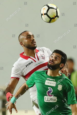 Zamalek player Kahraba (L)  in action against  Al-Ittihad player  Kabonga (R) during the Egyptian Premier League football match  between Zamalek and Al-Ittihad  in Cairo, Egypt, 04 August 2018.