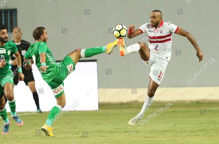Zamalek player Kahraba (R)  in action against  Al-Ittihad player  Kabonga (L) during the Egyptian Premier League football match  between Zamalek and Al-Ittihad  in Cairo, Egypt, 04 August 2018.
