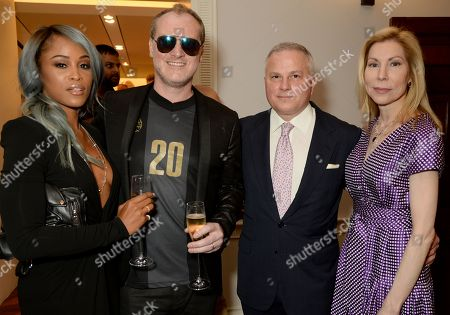 Stock Picture of Eve Jeffers Cooper, Maximillion Cooper, John Rigas and Darcy Rigas