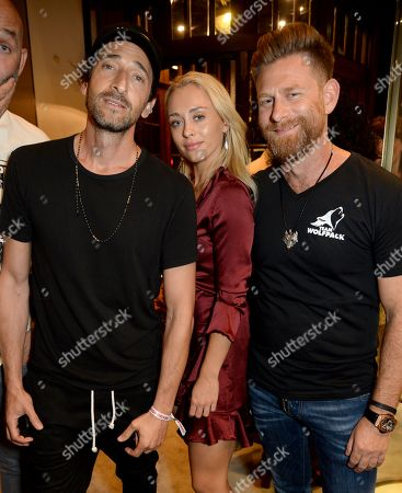 Stock Photo of Adrien Brody, guest and Josh Cartu