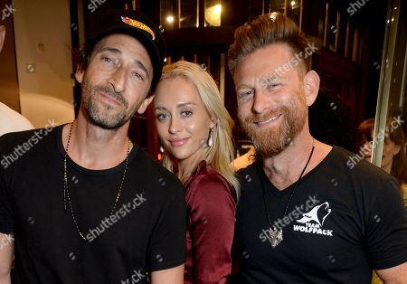 Stock Picture of Adrien Brody, guest and Josh Cartu