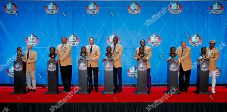 The Pro Football Hall of Fame class of 2018, minus Terrell Owens, poses with their busts following inductions, in Canton, Ohio. From left are Bobby Beathard, Robert Brazile, Brian Urlacher, Randy Moss, Ray Lewis, Jerry Kramer and Brian Dawkins