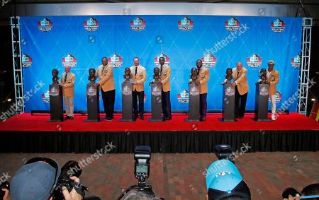 The Pro Football Hall of Fame class of 2018, minus Terrell Owens, poses with their busts following inductions at the hall, in Canton, Ohio. From left Bobby Beathard, Robert Brazile, Brian Urlacher, Randy Moss, Ray Lewis, Jerry Kramer and Brian Dawkins
