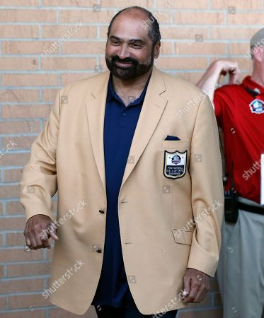Former NFL player Franco Harris arrives for the induction into the Pro Football Hall of Fame, in Canton, Ohio
