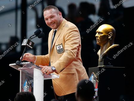 Brett Favre. Former NFL player Brian Urlacher delivers his speech during an induction ceremony at the Pro Football Hall of Fame, in Canton, Ohio