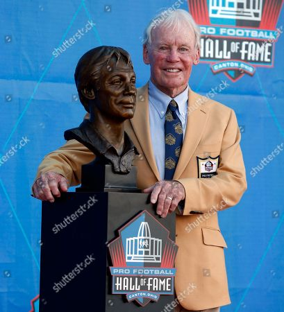 Brett Favre. Former NFL contributor Bobby Beathard poses with his bust after being inducted into the Pro Football Hall of Fame, in Canton, Ohio
