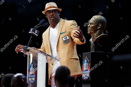 Brett Favre. Former NFL player Brian Dawkins delivers his speech during an induction ceremony at the Pro Football Hall of Fame, in Canton, Ohio