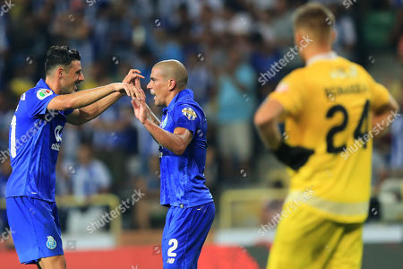 Fc Porto?s Maxi Pereira (R), celebrates with his teammate, Andre Pereira (L), after scoring a goal against Desportivo das Aves during the Portuguese Candido de Oliveira Supercup soccer match, held at Aveiro Municipal Stadium, in Aveiro, Portugal, 04 August 2018.