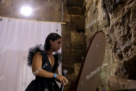 """Tunisian singer and song writer Emel Mathlouthi backstage before her concert during the Jordan Festival at the Odeon Theater in Amman, Jordan, 04 August 2018. Jordan festival takes place between 02 and 08 August. Mathlouthi sings in Arabic and English an alternative style of music, she is best known  for her song """"Kelmti Horra"""" (my word is free in Arabic) which became an anthem of the Tunisian revolution and which she sung at the Peace Nobel Prize ceremony and concert in 2015."""