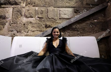 """Tunisian singer and song writer Emel Mathlouthi backstage after her concert during the Jordan Festival at the Odeon Theater in Amman, Jordan, 04 August 2018. Jordan festival takes place between 02 and 08 August. Mathlouthi sings in Arabic and English an alternative style of music, she is best known  for her song """"Kelmti Horra"""" (my word is free in Arabic) which became an anthem of the Tunisian revolution and which she sung at the Peace Nobel Prize ceremony and concert in 2015."""