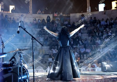 """Tunisian singer and song writer Emel Mathlouthi performs during her concert at the Jordan Festival at the Odeon Theater in Amman, Jordan, 04 August 2018. Jordan festival takes place between 02 and 08 August. Mathlouthi sings in Arabic and English an alternative style of music, she is best known  for her song """"Kelmti Horra"""" (my word is free in Arabic) which became an anthem of the Tunisian revolution and which she sung at the Peace Nobel Prize ceremony and concert in 2015."""