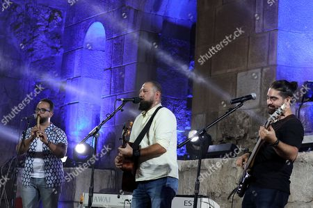 Stock Picture of Members of the Jordanian band Guitanai perform during the first part of Emel Mathlouthi concert at the Jordan Festival at the Odeon Theater in Amman, Jordan, late 04 August 2018. Jordan festival takes place between 02 and 08 August.The band plays in Amman and festivals in the Middle East region, its name comes from the combination of its two main instruments the Nai flute and the guitar.