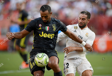 Juventus defender Medhi Benatia, left, battles for the ball against Real Madrid defender Daniel Carvajal (2) during the first half at an International Champions Cup tournament soccer match, in Landover, Md
