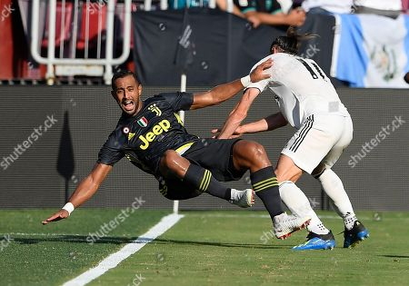 Real Madrid forward Gareth Bale, right, knocks over Juventus defender Medhi Benatia, left, during the first half at an International Champions Cup tournament soccer match, in Landover, Md