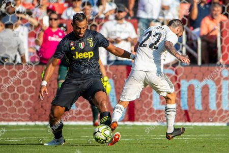 Juventus defender Medhi Benatia (L) and Real Madrid midfielder Isco (R) vie for the ball during the first half of the International Champions Cup soccer match between Real Madrid and Juventus at FedExField in Landover, Maryland, USA, 04 August 2018.