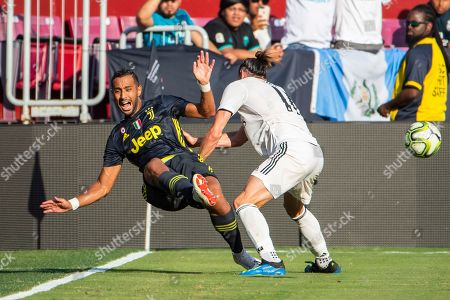 Real Madrid forward Gareth Bale (R) slams into Juventus defender Medhi Benatia (L) during the first half of the International Champions Cup soccer match between Real Madrid and Juventus at FedExField in Landover, Maryland, USA, 04 August 2018.