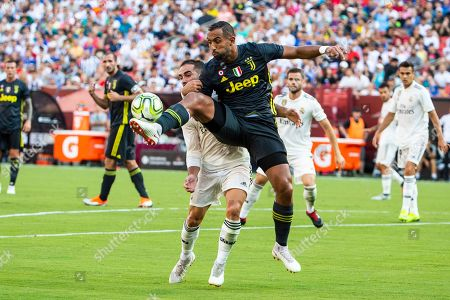 Juventus defender Medhi Benatia (C-R) and Real Madrid defender Dani Carvajal (C-L) vie for the ball during the first half of the International Champions Cup soccer match between Real Madrid and Juventus at FedExField in Landover, Maryland, USA, 04 August 2018.