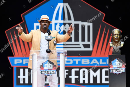 Former NFL player Brian Dawkins delivers a speech beside during an induction ceremony at the Pro Football Hall of Fame, in Canton, Ohio