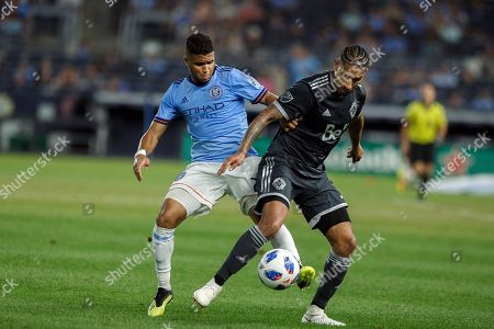 New York City FC's Ismael Tajouri-Shradi, left, vies for the ball with Vancouver Whitecaps' Sean Franklin, right, during the second half of an MLS soccer match, in New York