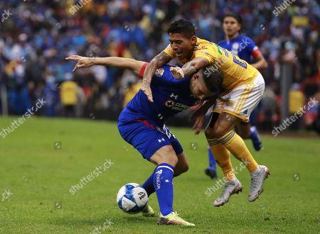 Ivan Marcone (L) of Cruz Azul in action against Javier Aquino (R) of Tigres UANL during the Apertura Tournament soccer match between Cruz Azul and Tigres UANL, at the Azteca Stadium in Mexico City, Mexico, 04 August 2018.