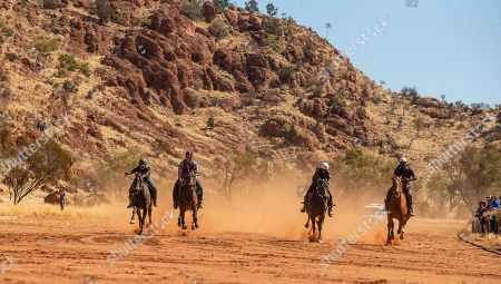 The field sprints down the home straight in a 200m race for stock hoses during the 71st annual Harts Range Races and Rodeo, approximately 215 km East of Alice Springs, Northern Territory, Australia, 04 August 2018 (issued 05 August 2018). Cut out of the bush of Mt. Riddock Station by The Webb brothers, The Harts Range track has been a mainstay of the Central Australian Pastoral communities since 1947. Unregistered station horses, local ringers, mounted police and Atitjere community members race, rodeo and revel in the bush skills they use every day with most of the money generated going to charity.