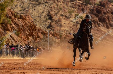 A competitor in action during the final 700m race at the 71st annual Harts Range Races and Rodeo, approximately 215 km East of Alice Springs, Northern Territory, Australia, 04 August 2018 (issued 05 August 2018). Cut out of the bush of Mt. Riddock Station by The Webb brothers, The Harts Range track has been a mainstay of the Central Australian Pastoral communities since 1947. Unregistered station horses, local ringers, mounted police and Atitjere community members race, rodeo and revel in the bush skills they use every day with most of the money generated going to charity.